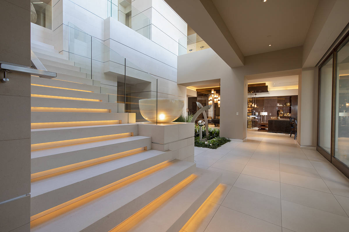 The stairs of the home. (Synergy Sotheby's International Realty)