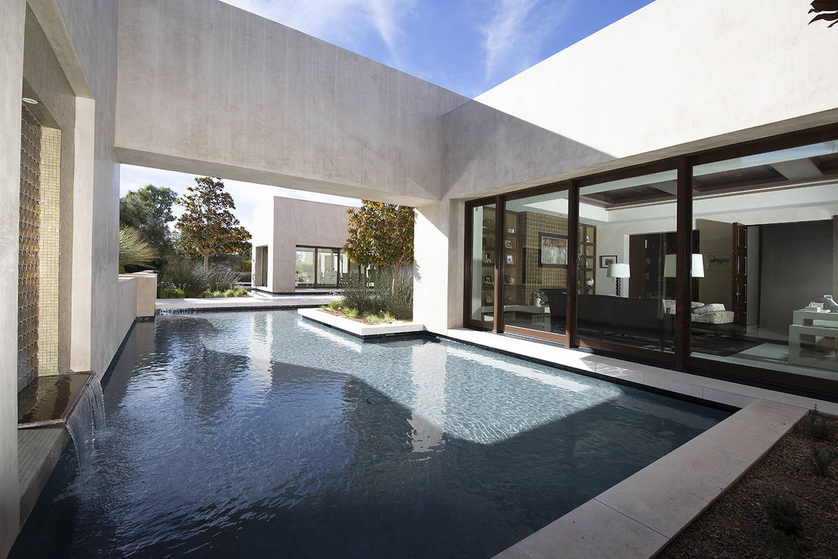 The office opens to the pool. (Synergy Sotheby's International Realty)