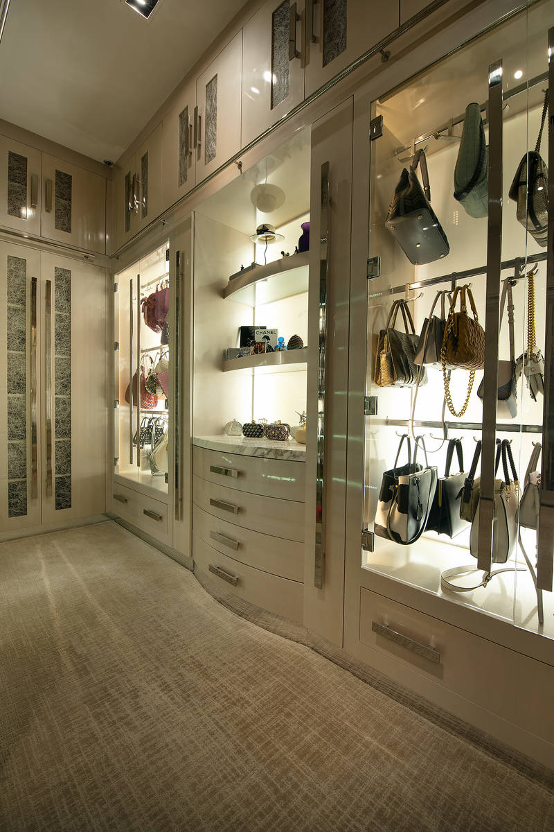 A closet in the master bedroom has a vitrine for displaying handbags as if they were art. (Syne ...