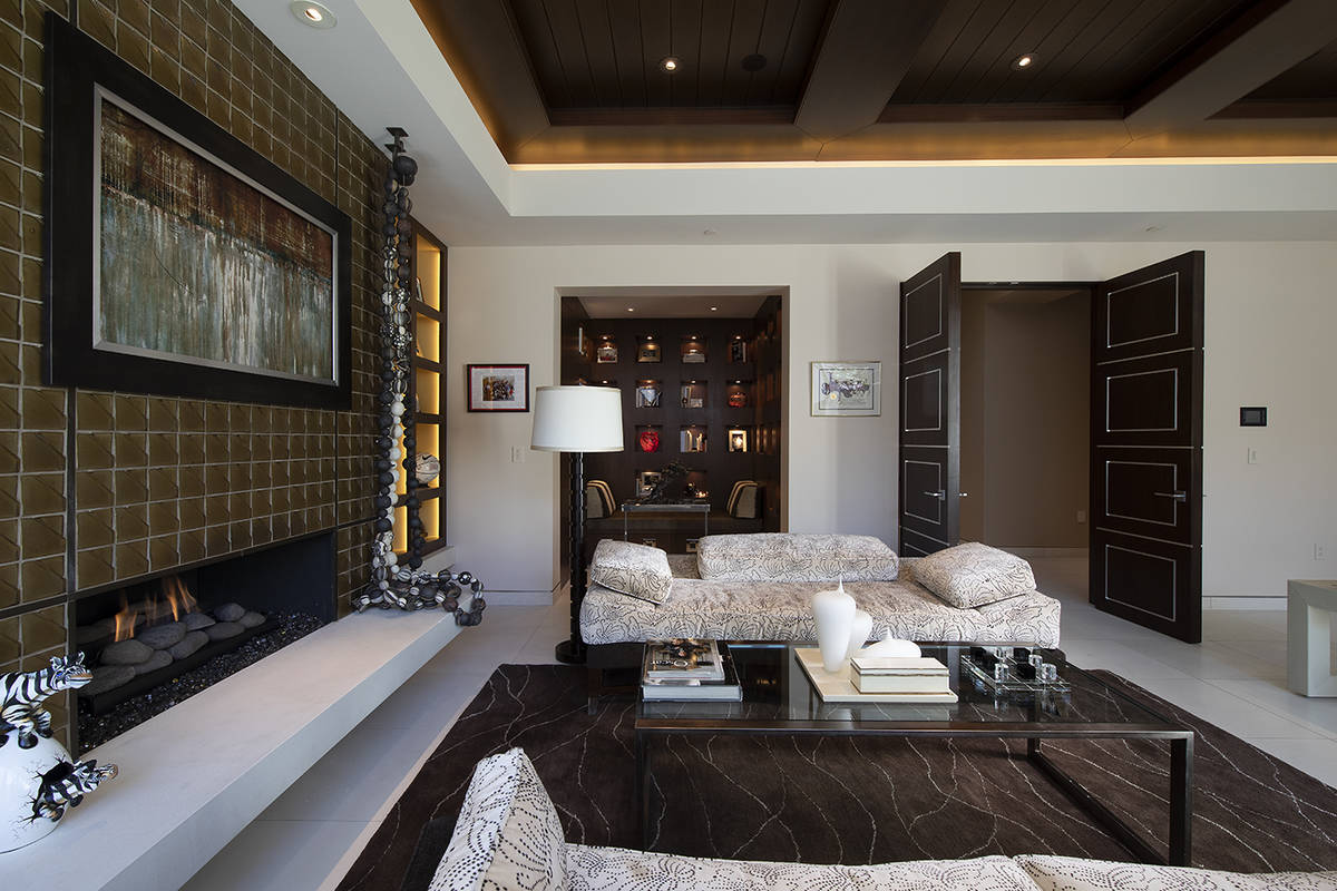 The office of the 17,5620-square foot Henderson mansion is more of a suite and opens to the poo ...