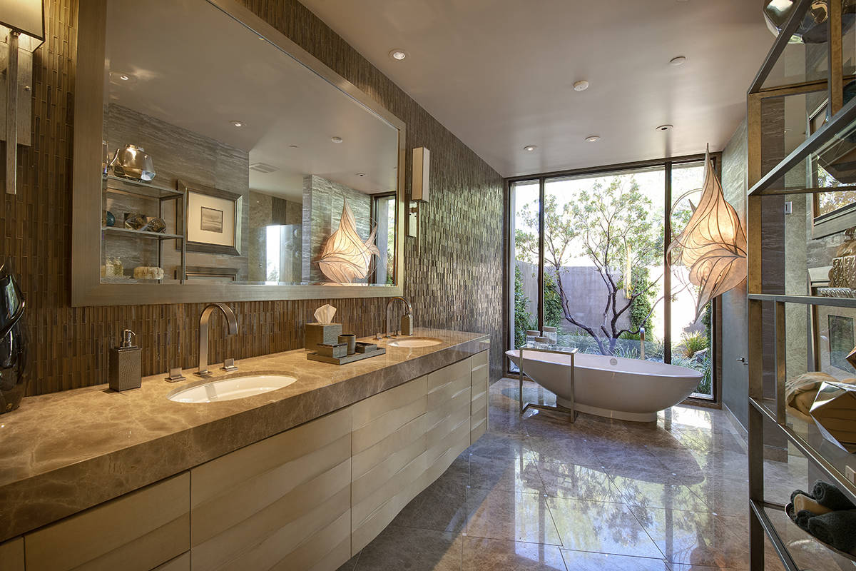 The 17,562-square-feet Henderson mansion has five bedrooms and 10 baths, including this large m ...