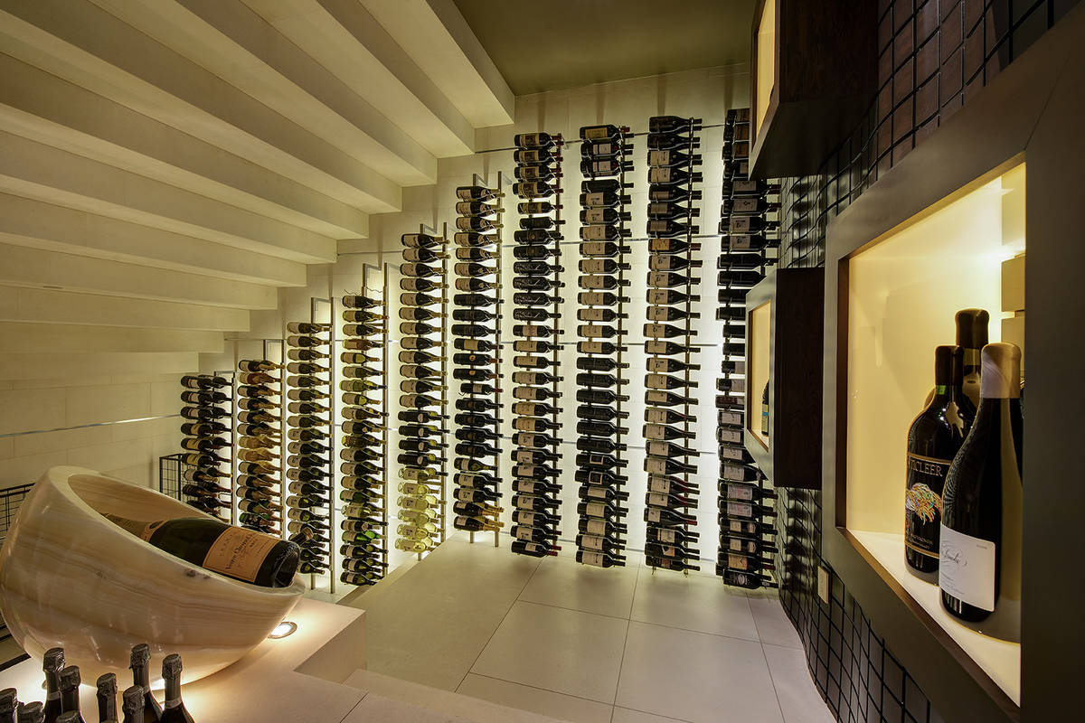 The home was built for entertainment and features a large wine cellar and game room. (Synergy S ...