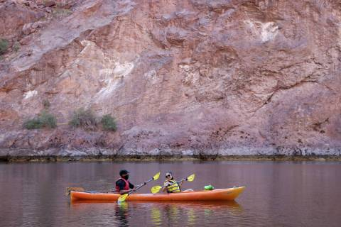 Jonathan Boyles and Dayana Garcia, both of Las Vegas, kayak on the Colorado River in Black Cany ...