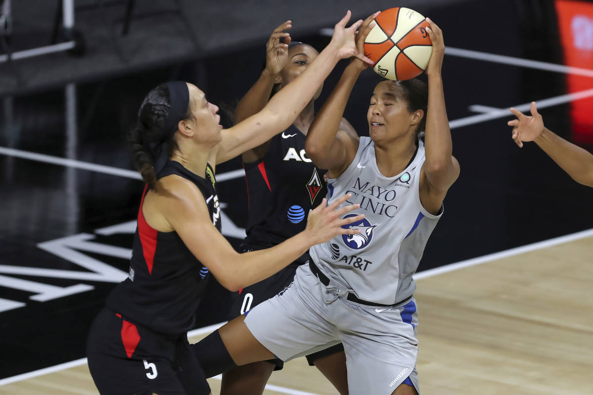 Minnesota Lynx's Napheesa Collier, right, is blocked by Las Vegas Aces' Dearica Hamby during th ...