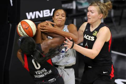 Las Vegas Aces' Jackie Young (0) knocks the ball away from Minnesota Lynx's Napheesa Collier as ...
