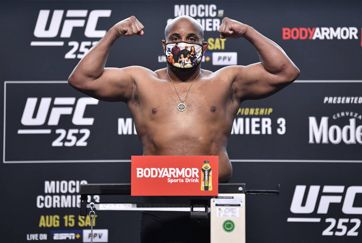 Daniel Cormier poses on the scale during the UFC 252 weigh-in at UFC APEX on August 14, 2020 in ...