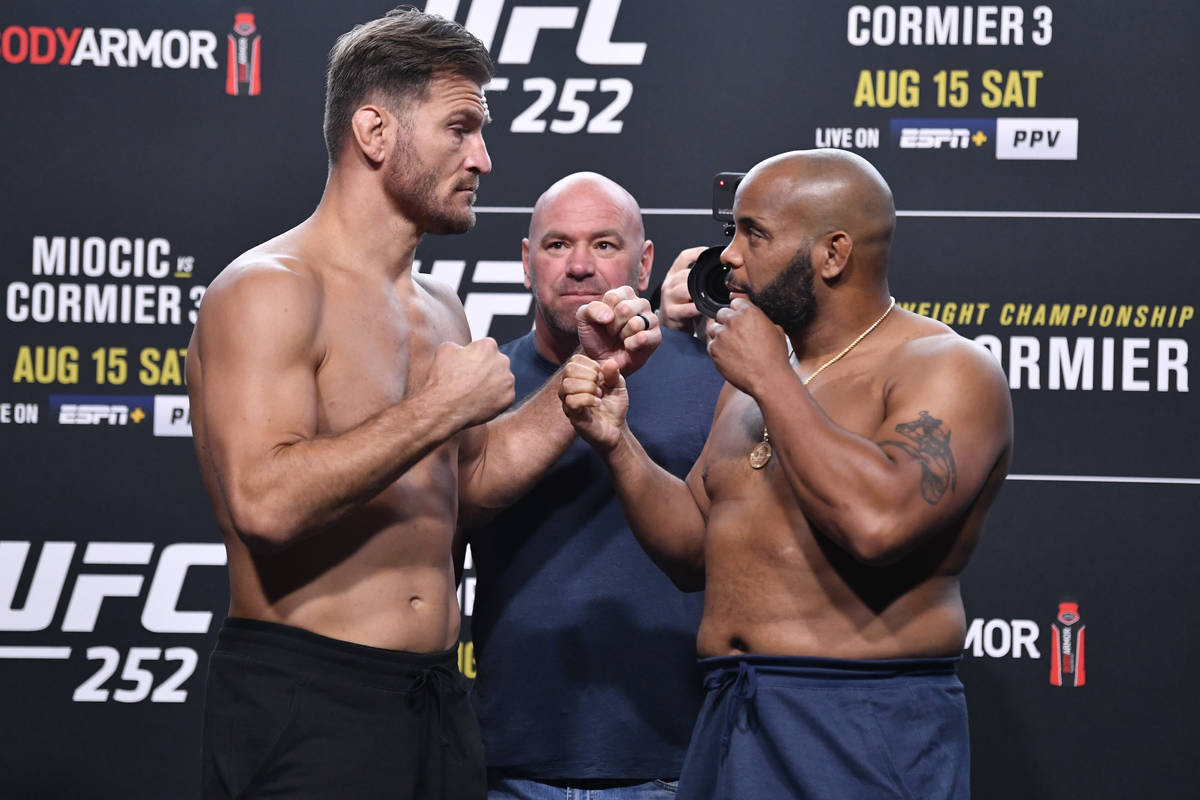 Opponents Stipe Miocic (left) and Daniel Cormier face off during the UFC 252 weigh-in at UFC AP ...
