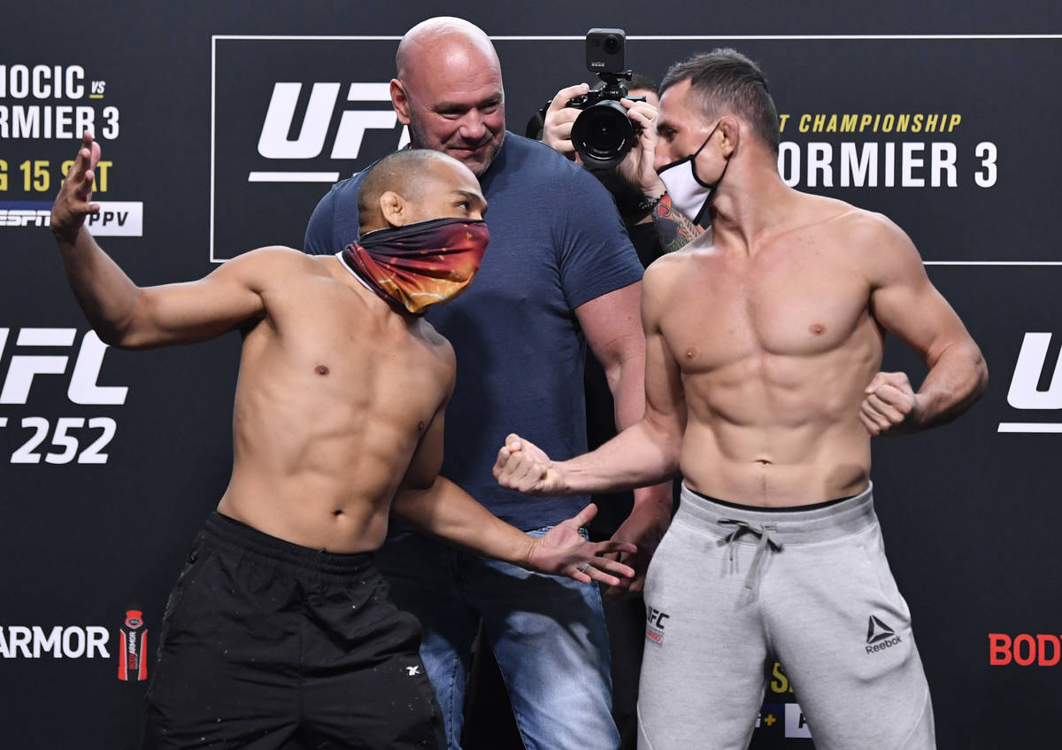 (L-R) Opponents John Dodson and Merab Dvalishvili of Georgia face off during the UFC 252 weigh- ...