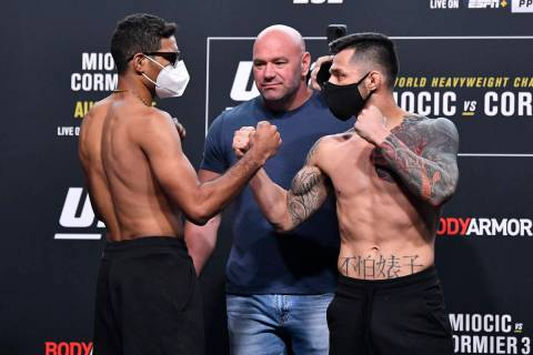 (L-R) Opponents Herbert Burns of Brazil and Daniel Pineda face off during the UFC 252 weigh-in ...
