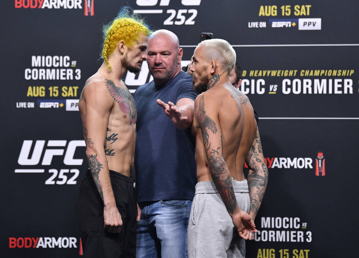 (L-R) Opponents Sean O'Malley and Marlon Vera of Ecuador face off during the UFC 252 weigh-in a ...