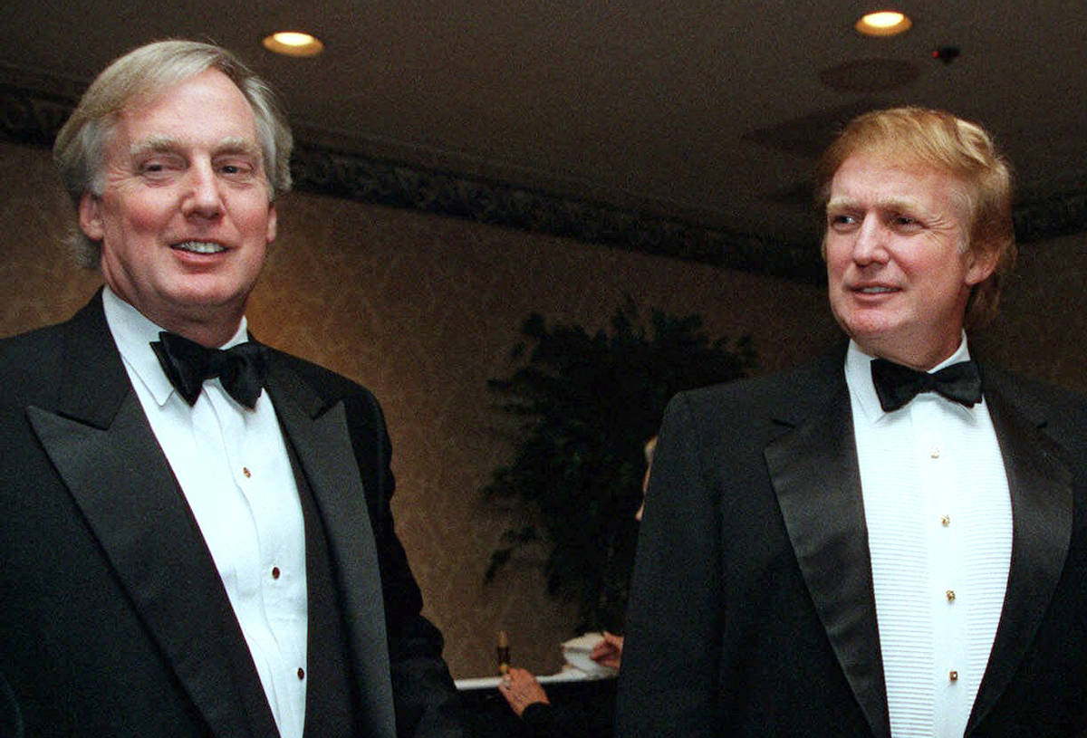 In this Nov. 3, 1999 file photo, Robert Trump, left, joins then real estate developer and presi ...