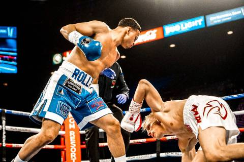 Lightweight boxer and Las Vegas native Rolando Romero (left) fights Arturs Ahmetovs at MGM Gran ...