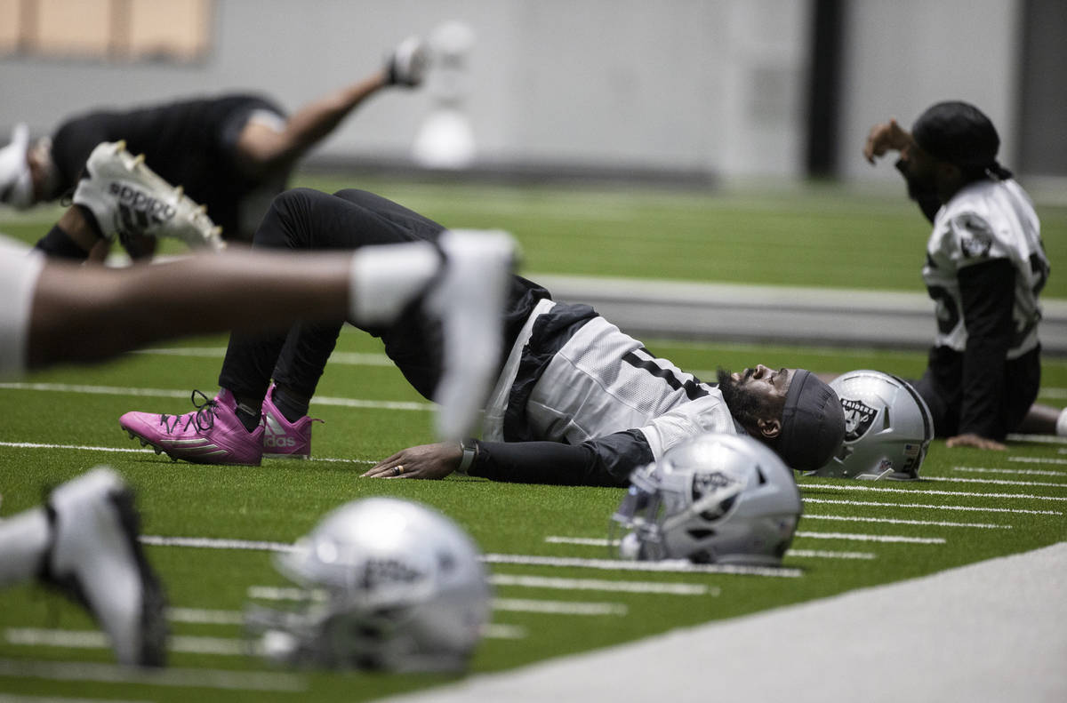 Raiders defensive back Trayvon Mullen (27) stretches during an NFL football training camp pract ...