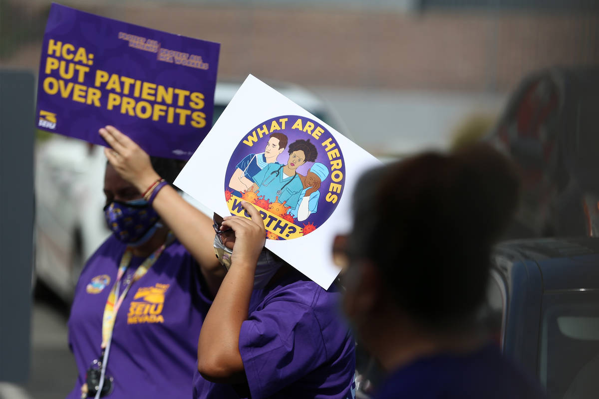Health care workers with SEIU Local 1107 HCA stand outside of the Nevada Division of Public Hea ...