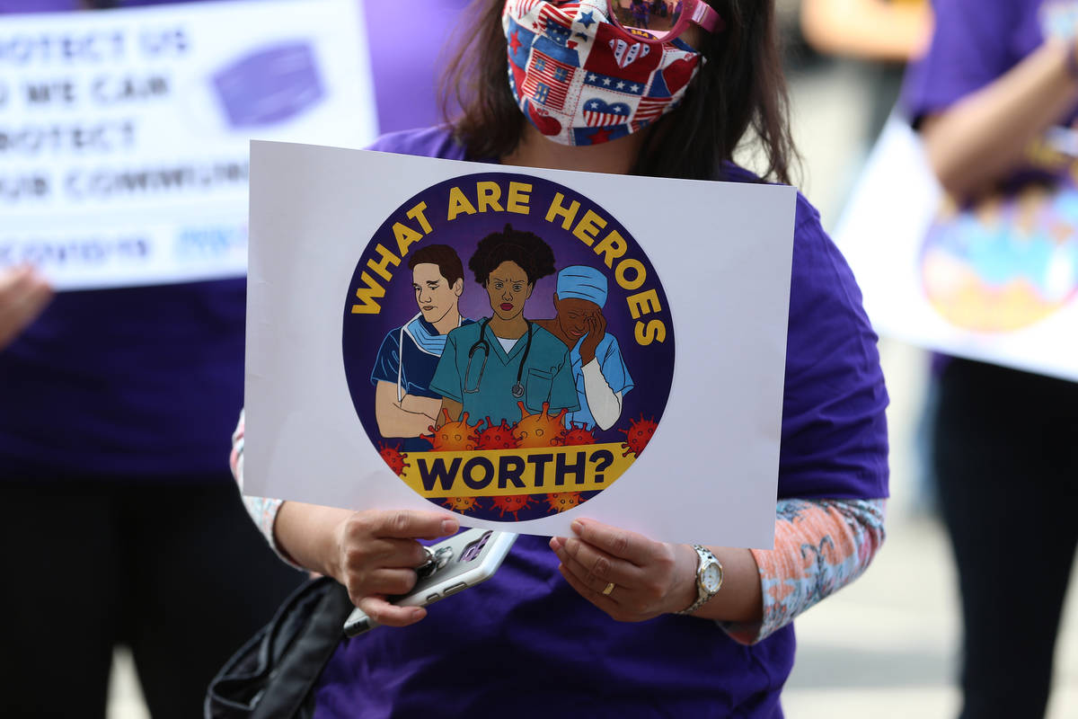 A SEIU Local 1107 HCA health care worker stands outside of the Nevada Division of Public Health ...