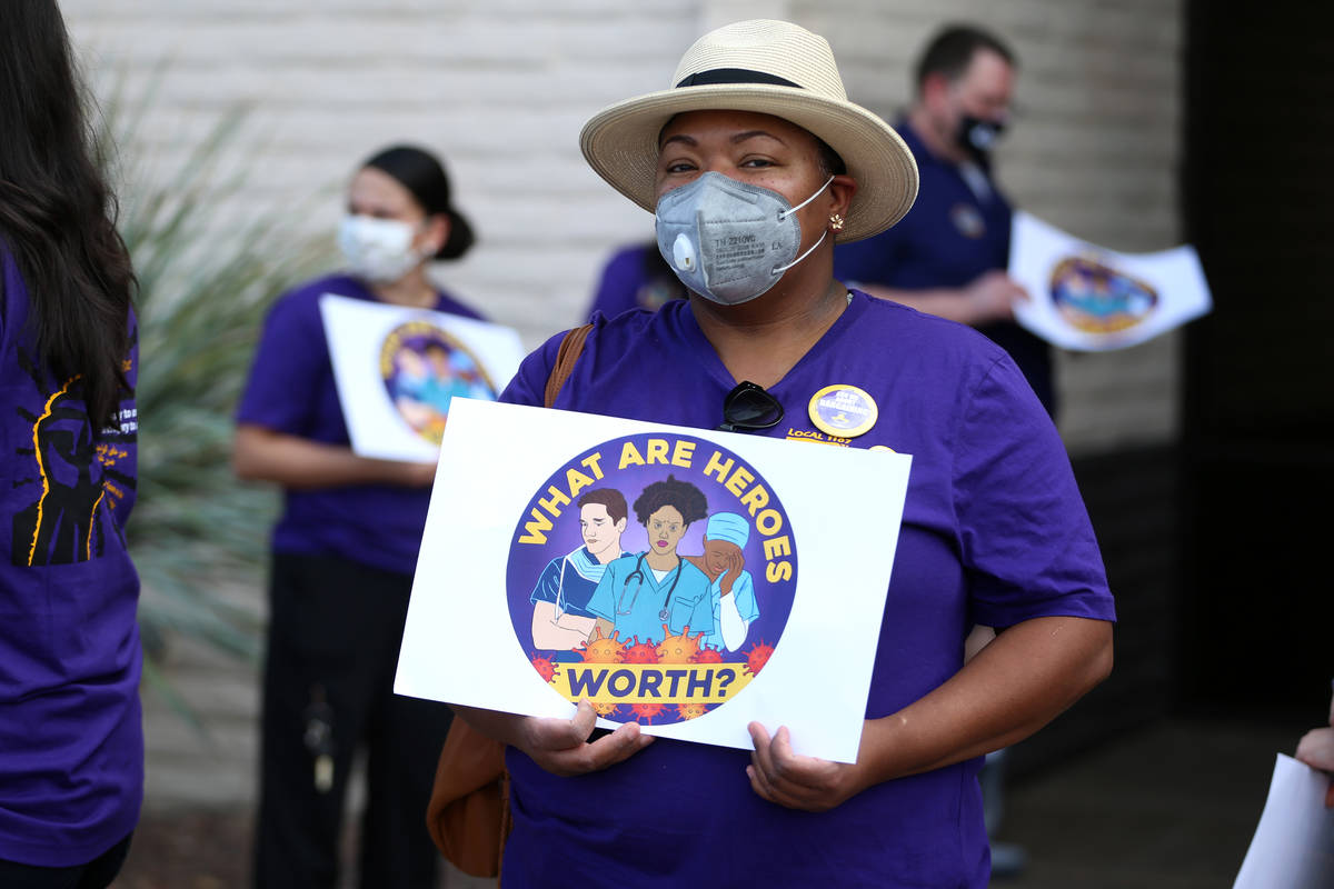 SEIU Local 1107 HCA health care worker Zabia Norman stands outside of the Nevada Division of Pu ...