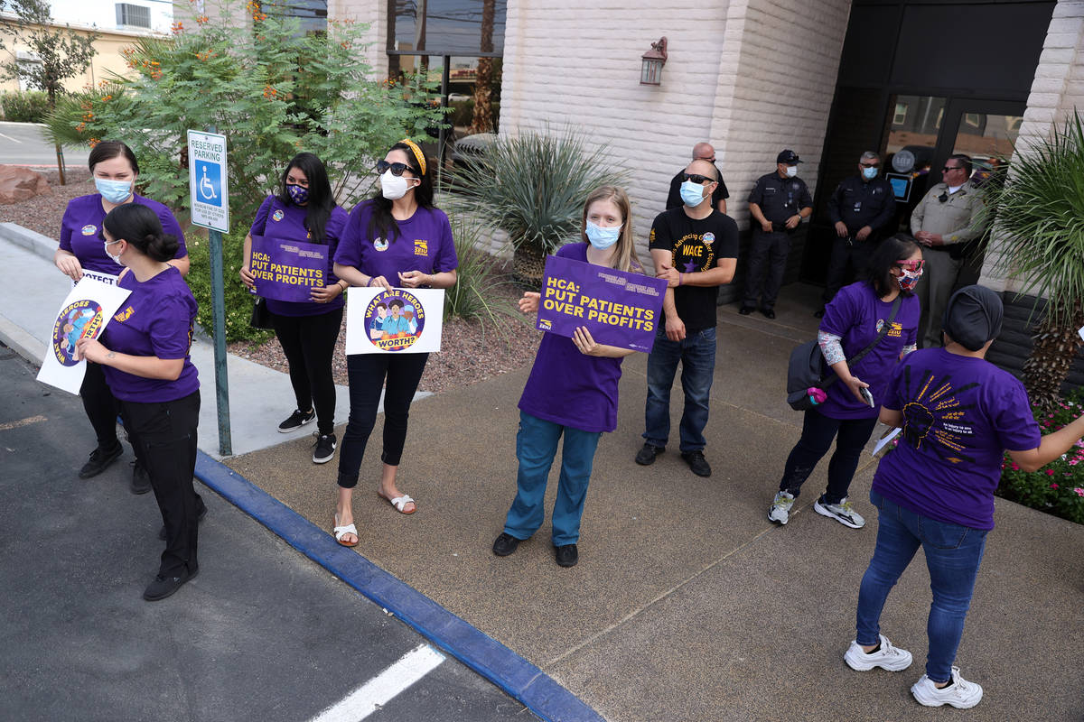 SEIU Local 1107 HCA health care workers stand outside of the Nevada Division of Public Health b ...