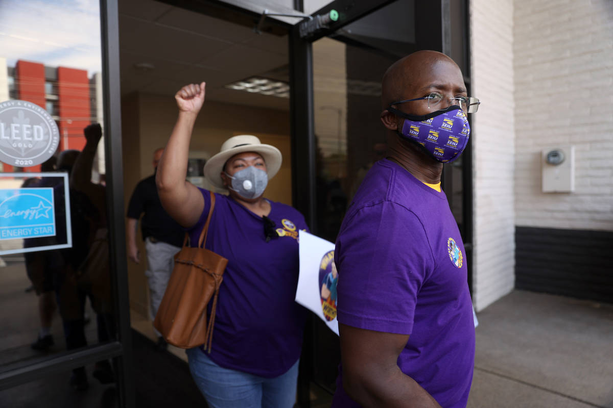 SEIU Local 1107 HCA health care workers Mike Forson, right, and Zabia Norman exit the building ...