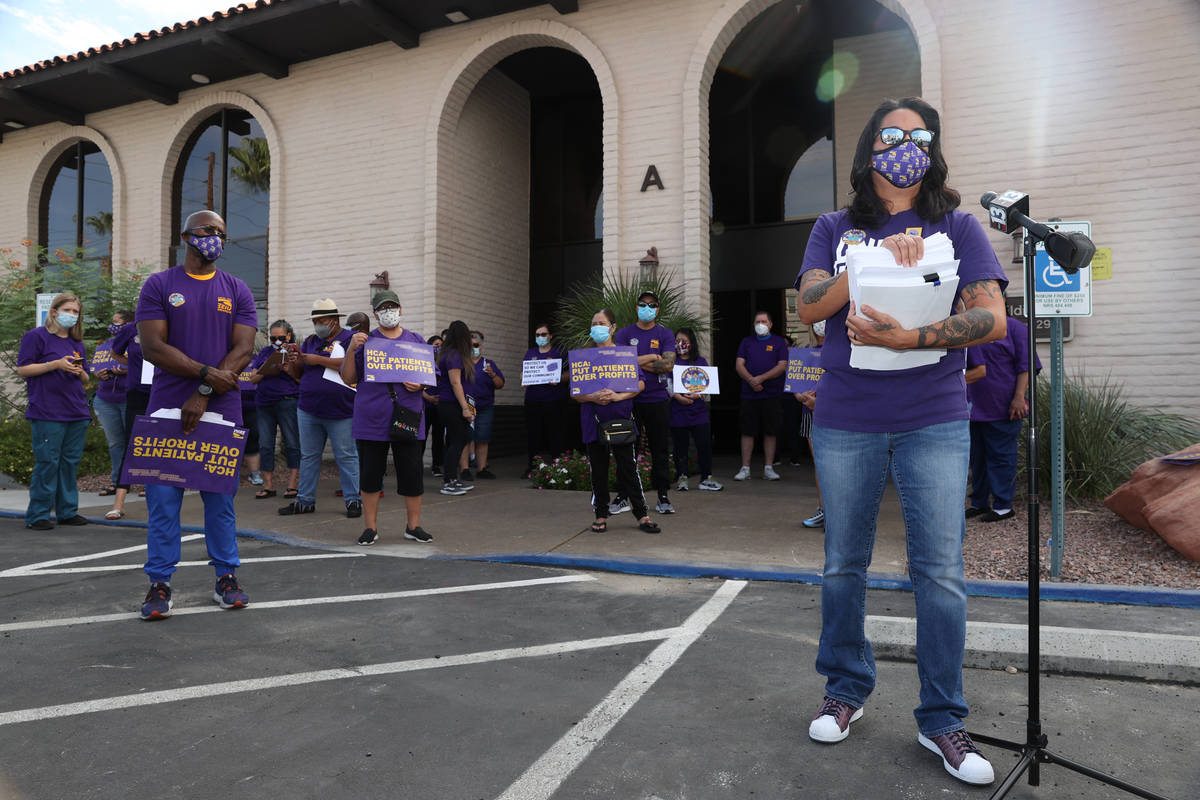 SEIU Local 1107 HCA healthcare worker Erika Watanabe speaks to the press while waiting to deliv ...