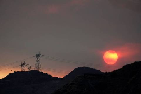 The sun sets through smoke created by the Ranch Fire, Thursday, Aug. 13, 2020, in Azusa, Calif. ...