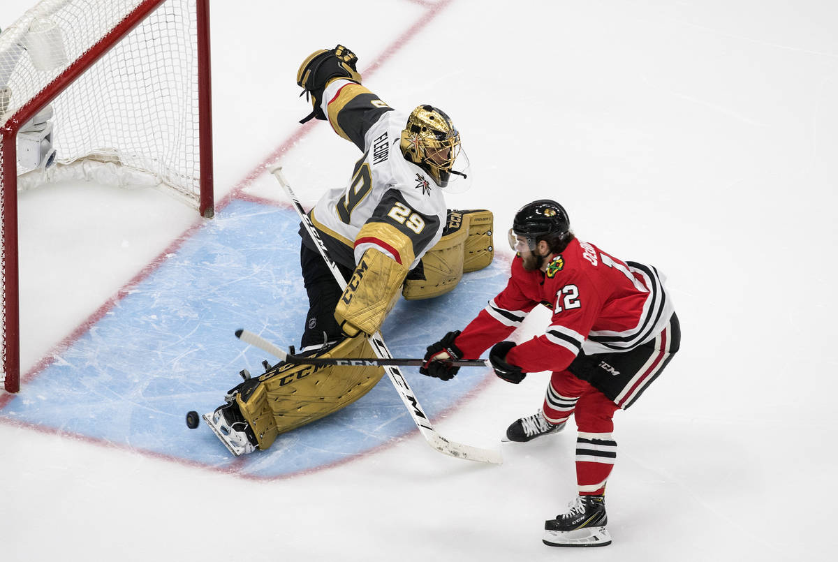 Vegas Golden Knights goalie Marc-Andre Fleury (29) makes the save on Chicago Blackhawks' Alex D ...