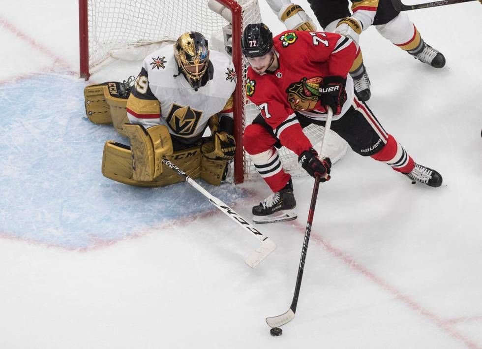 Vegas Golden Knights goalie Marc-Andre Fleury (29) watches as Chicago Blackhawks' Kirby Dach (7 ...