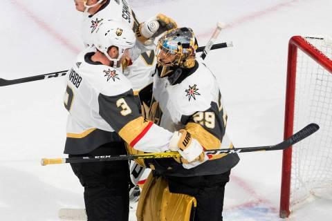 Vegas Golden Knights' Brayden McNabb (3) and goalie Marc-Andre Fleury (29) celebrate the win ov ...
