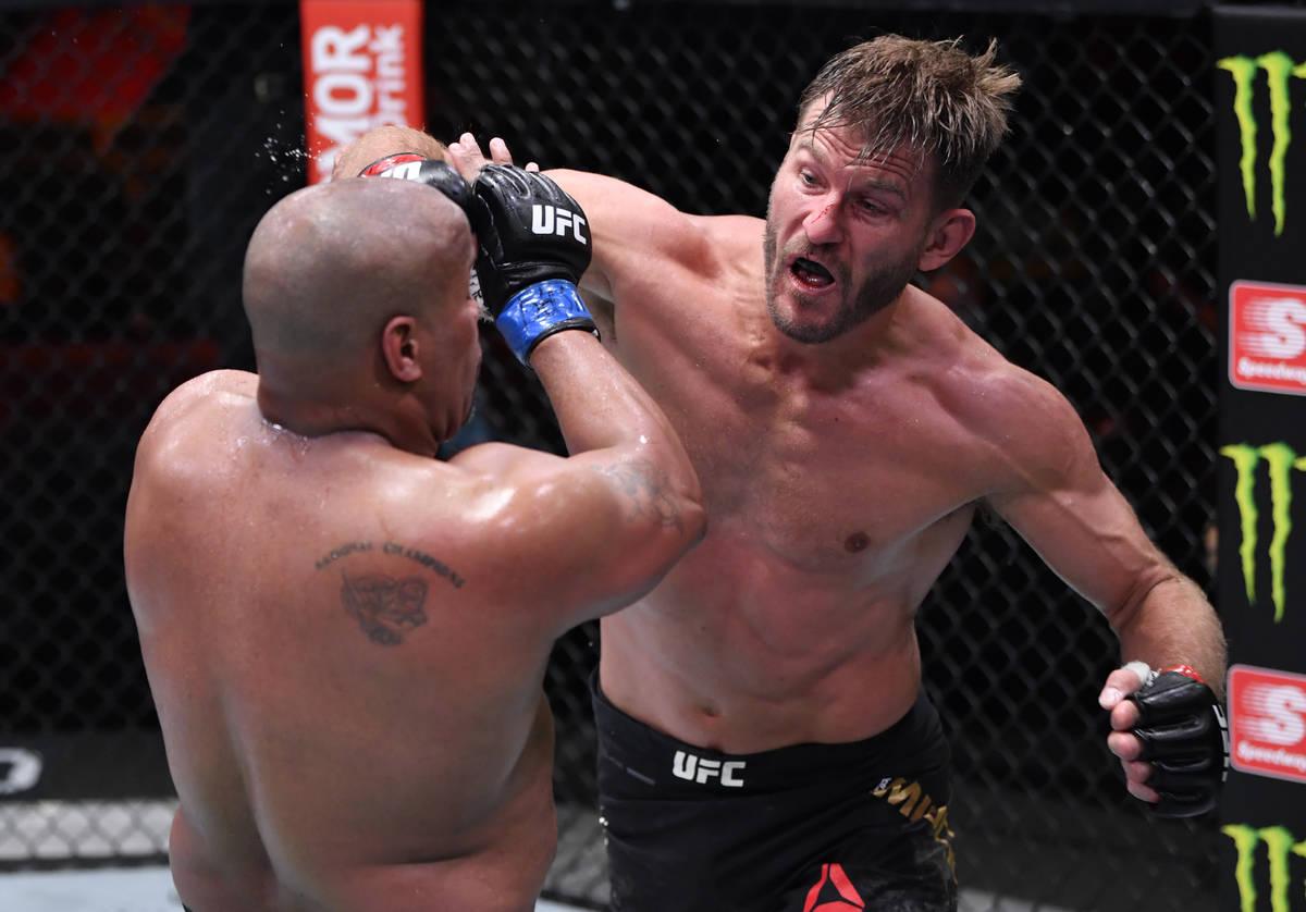 LAS VEGAS, NEVADA - AUGUST 15: (R-L) Stipe Miocic punches Daniel Cormier in their UFC heavyweig ...