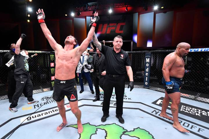 LAS VEGAS, NEVADA - AUGUST 15: Stipe Miocic celebrates after his victory over Daniel Cormier in ...