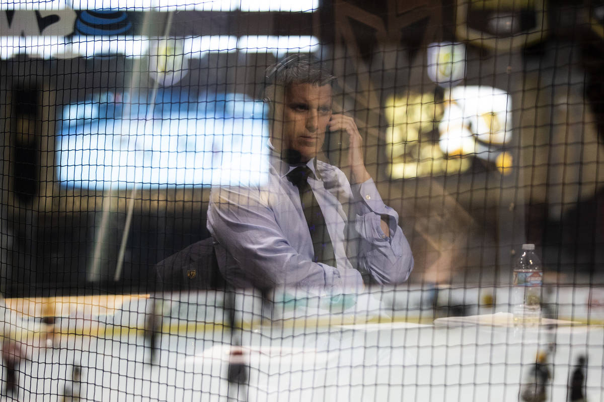 Vegas Golden Knights pregame show host Daren Millard is reflected in the window while he answer ...