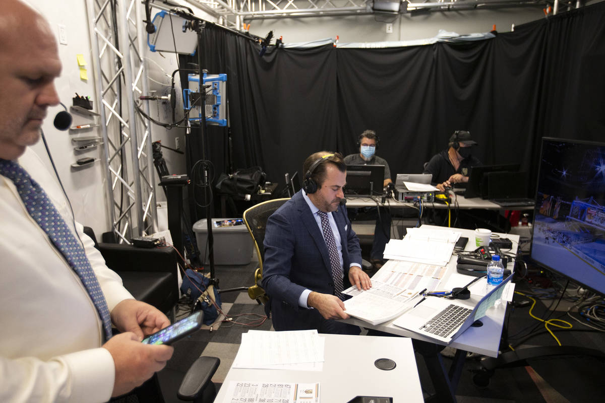 Broadcaster Dan D'Uva announces the play-by-play for the against the Chicago Blackhawks on Sund ...
