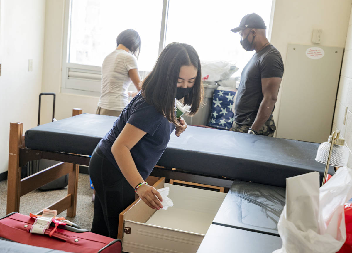 UNLV freshman Lia Cheung, 18, of Miami, sanitizes her furniture in her dorm at Dayton Hall, in ...