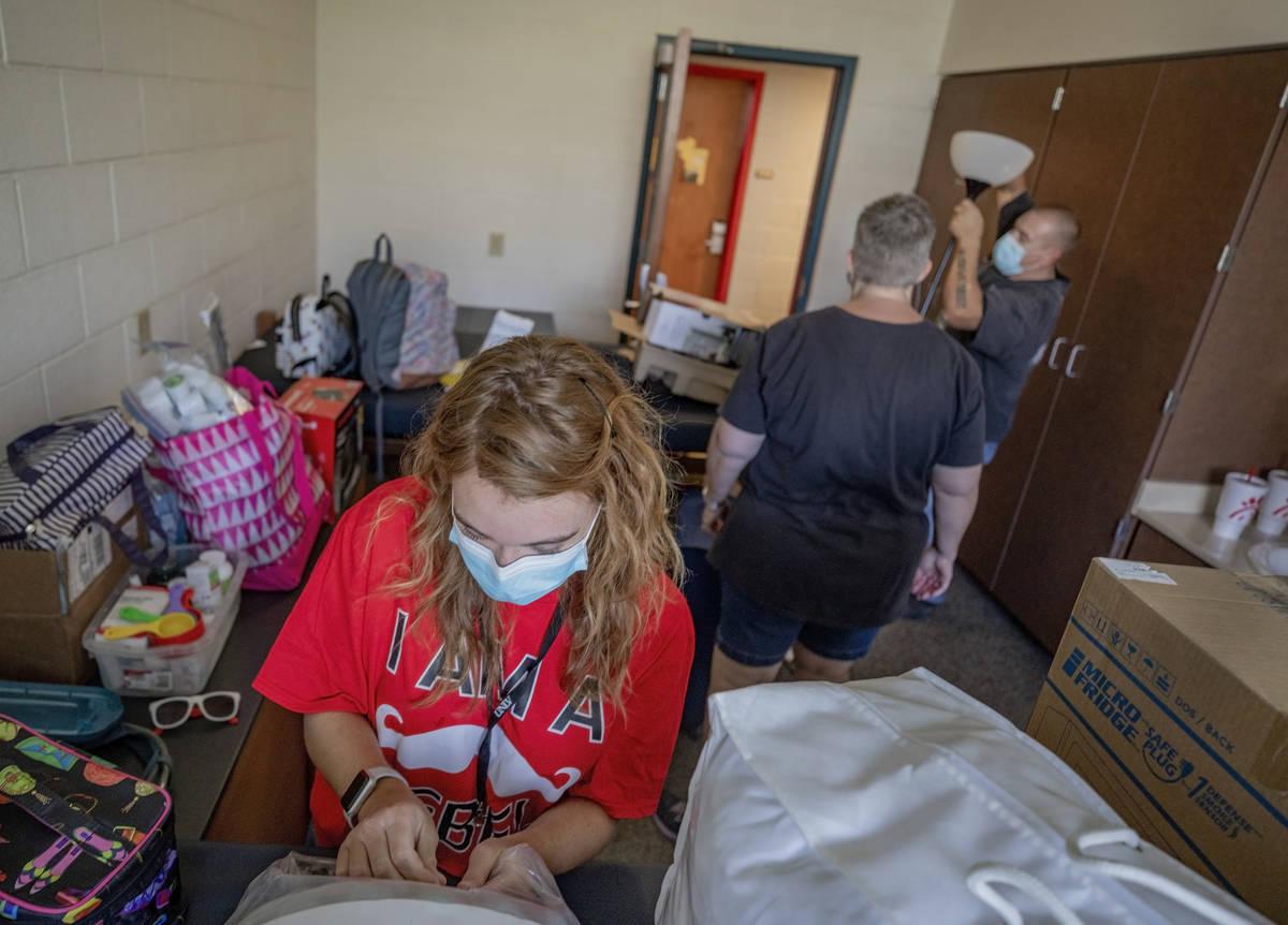 UNLV freshman Amanda Nowak, 18, of Henderson, unpacks her dorm room with the help of her parent ...