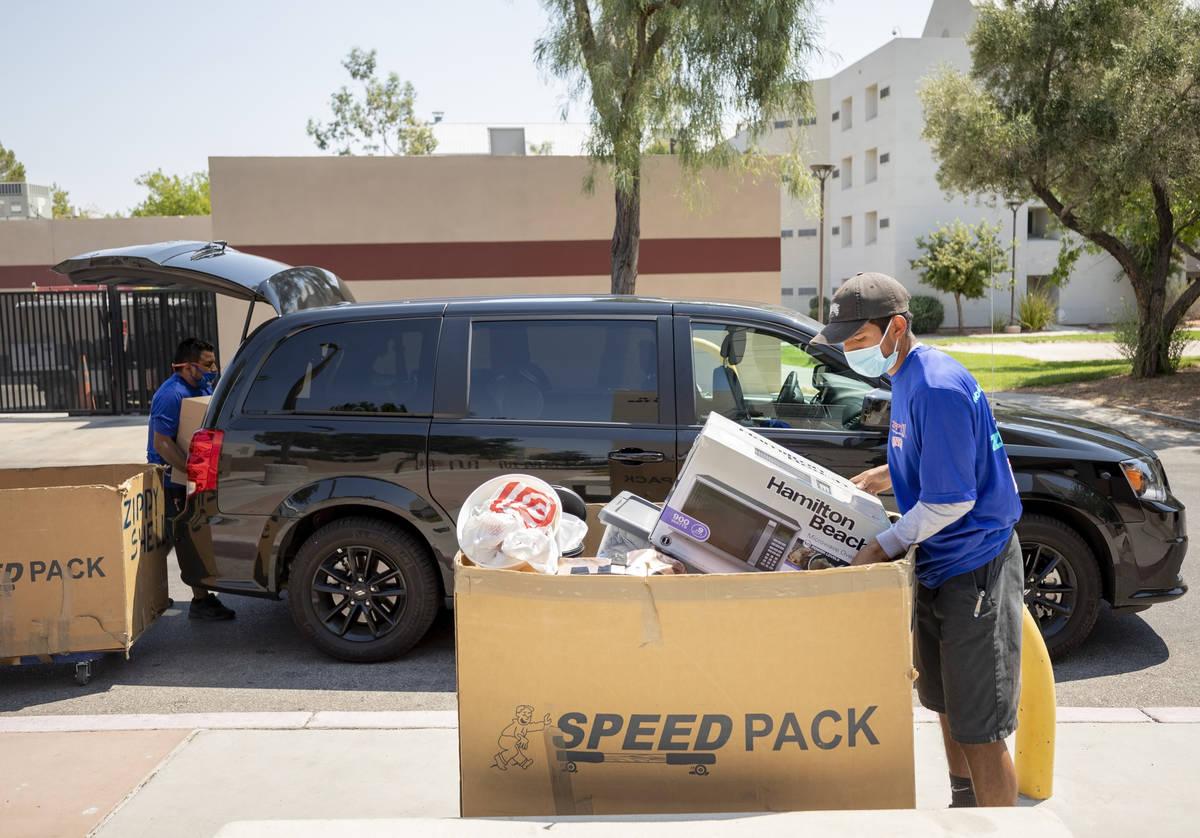 Zippy Shell of Las Vegas helps unload UNLV freshmanÕs luggage into Dayton Hall at UNLV in ...