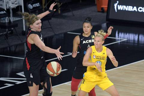 Chicago Sky guard Courtney Vandersloot (22) passes the ball in front of Las Vegas Aces center C ...