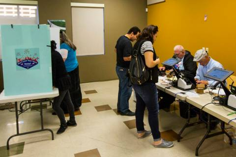 People check in to cast their votes at a polling station at Stupak Community Center in Las Vega ...