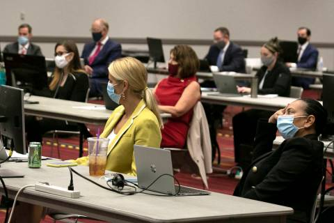 Attorneys in a trial over marijuana dispensary licenses listen during closing arguments at the ...