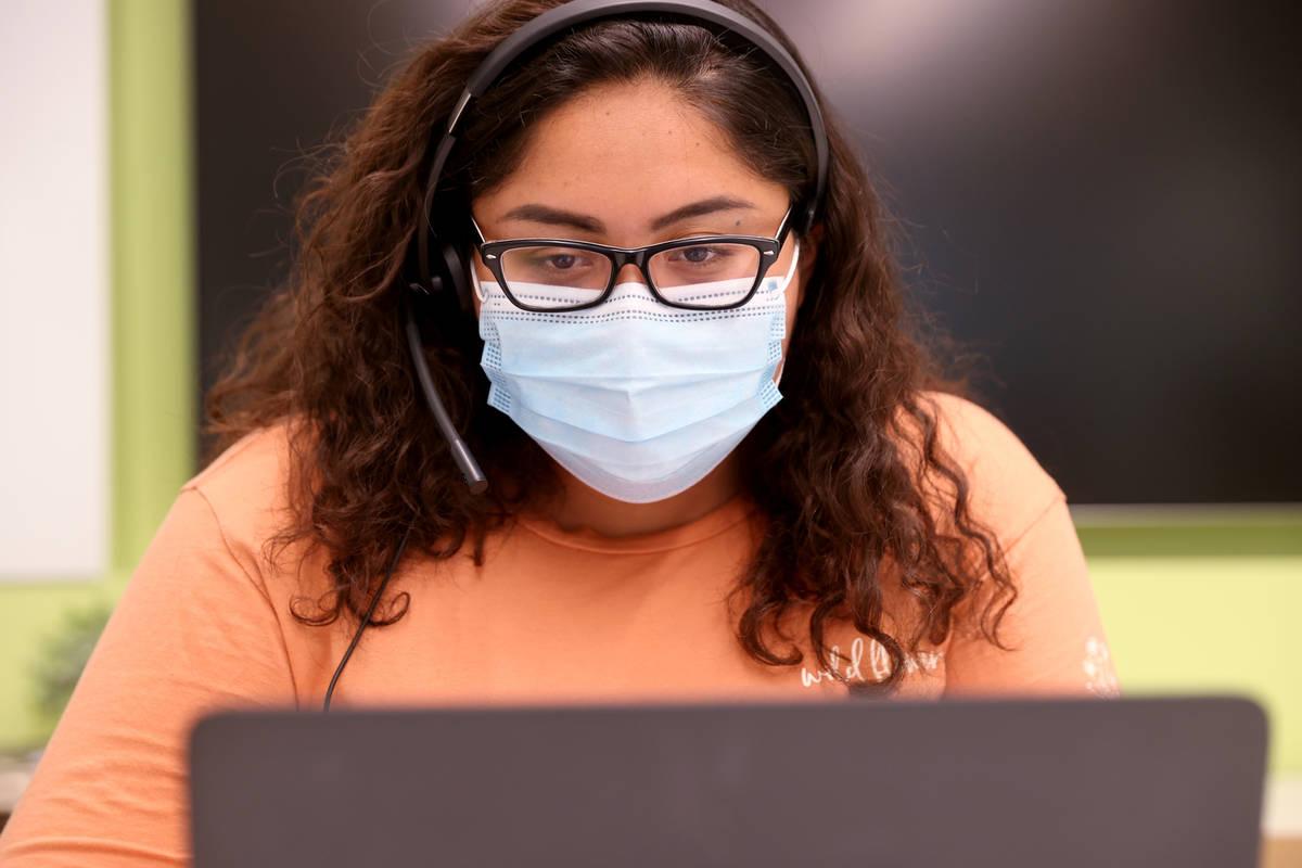 UNLV School of Public Health student Yareli Romualdo works on COVID-19 contract tracing Thursda ...