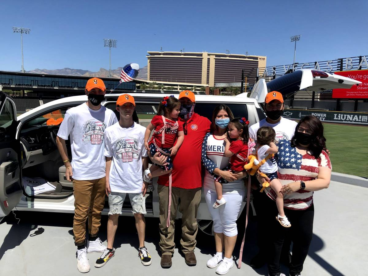 Retired Army National Guard specialist Steven Stanley and his wife, Christine, center, are surr ...