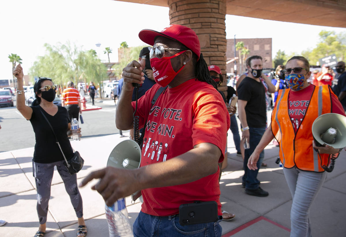 James Reed, Culinary Union Local 226 organizer, shouts slogans as union members rally outside o ...