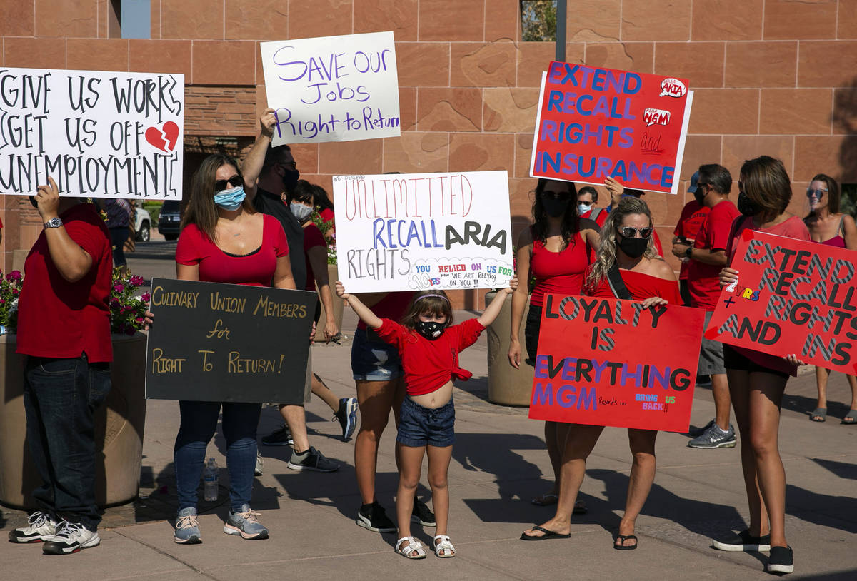 Charlie Gonzalez, 6, center, joins her mother Alana, center standing behind her, and union memb ...
