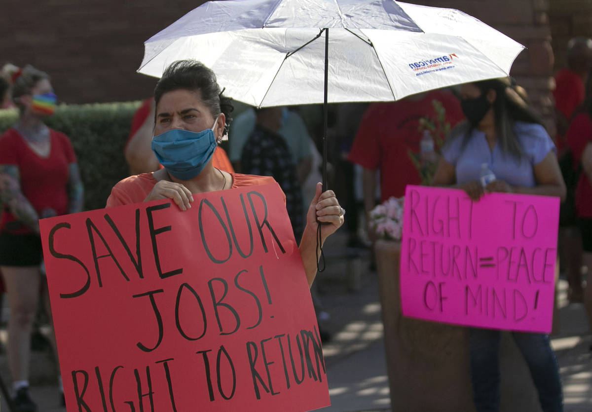 Union members, including Gabriela Rivera, rally outside of the Clark County Commission Building ...