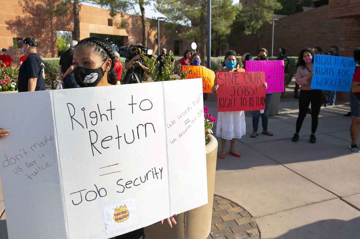 Michelle Weigum, left, and union members rally outside of the Clark County Commission Building ...