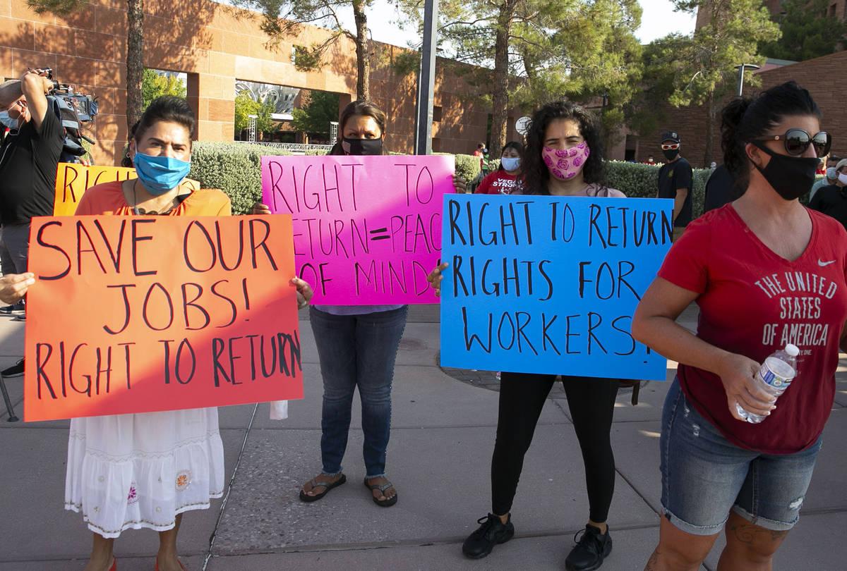 Gabriela Rivera, left, Isabel Macias and Bertha Regalado rally outside of the Clark County Comm ...