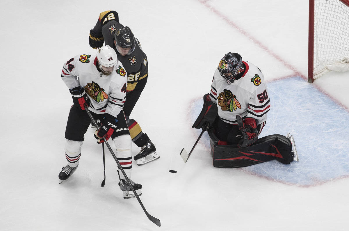 Vegas Golden Knights' Paul Stastny (26) is stopped by Chicago Blackhawks goalie Corey Crawford ...