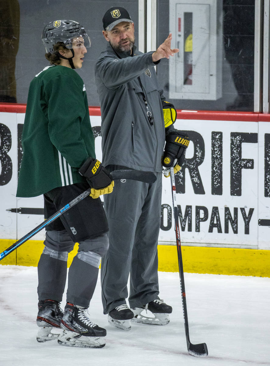 In this July 23, 2020, file photo, Vegas Golden Knights head coach Peter DeBoer, right, talks ...