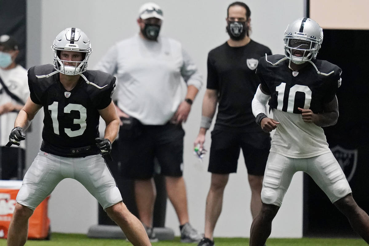 Las Vegas Raiders wide receiver Hunter Renfrow (13) and wide receiver Rico Gafford (10) warm up ...