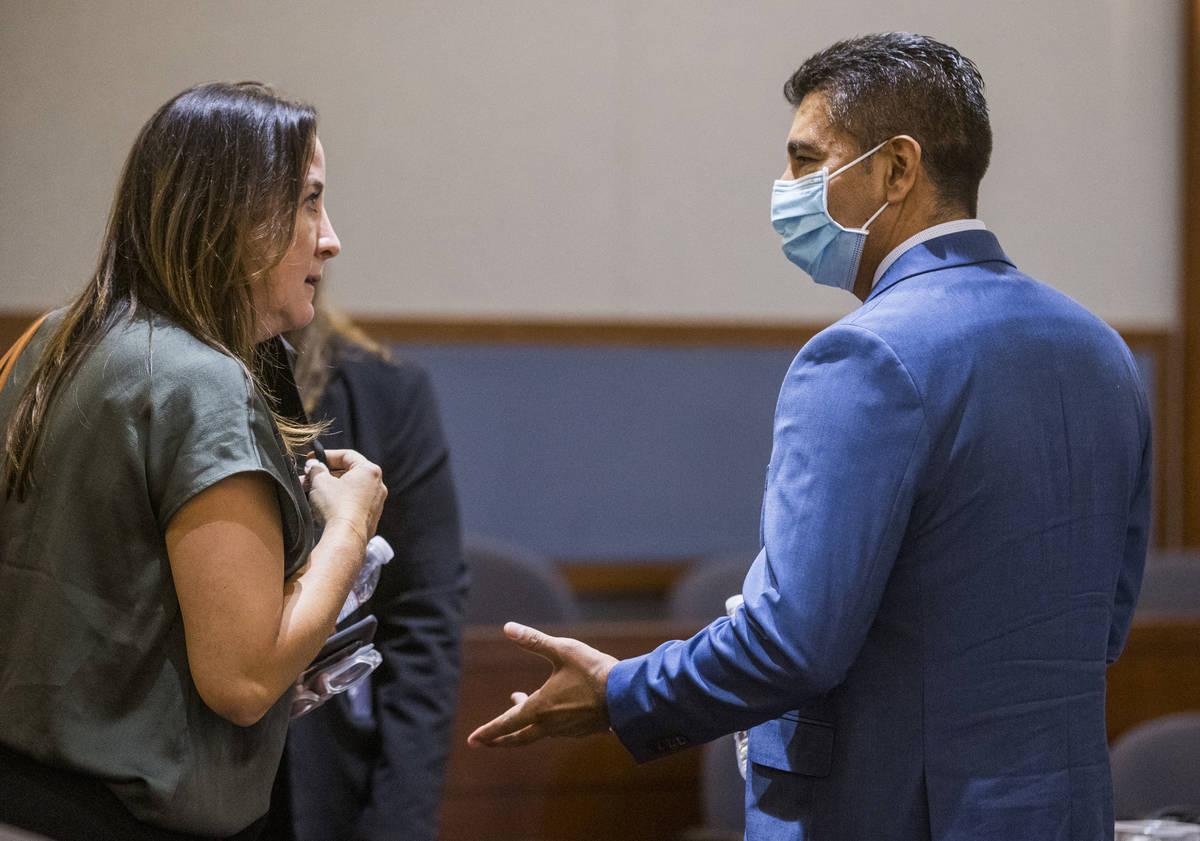 Attorney Kristina Wildeveld, left, talks in court with defendant Adolfo Orozco during a prelimi ...