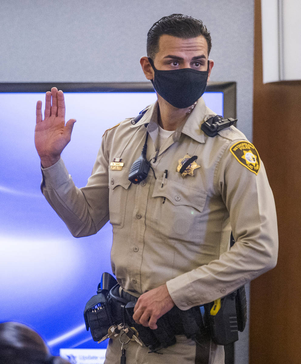 Metro officer Nolan Daniel is sworn in as a witness during a preliminary hearing for Adolfo Oro ...