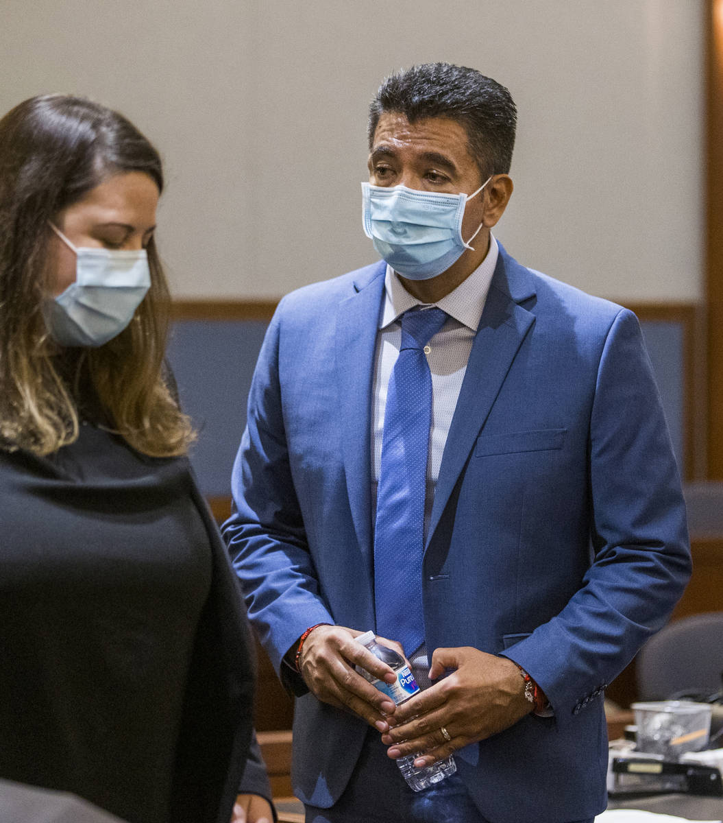 Defendant Adolfo Orozco leaves the courtroom with an attorney during a preliminary hearing in t ...